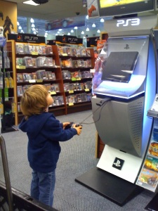 M playing video games at Fry's