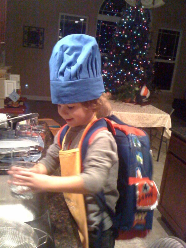 Chef M doing dishes (and heading to school??) - 3.5yo